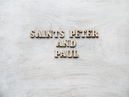 Saints Peter and Paul. Wooden, unpainted letters on a white table. Close-up, top view. Beautiful photo. Congratulations for loved ones, family, relatives, friends and colleagues Stockfoto