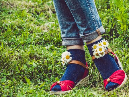 Womens legs, fashionable shoes and bright socks Reklamní fotografie - 125338077
