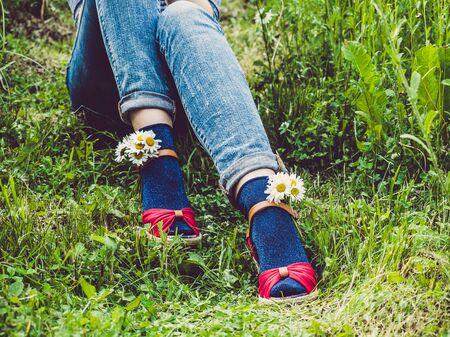 Womens legs, fashionable shoes and bright socks Reklamní fotografie - 125338088