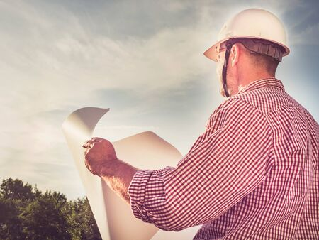 Handsome engineer in a white hard hat Stock Photo