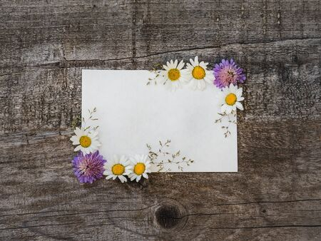 Beautiful bouquet of bright flowers, blank notepad page and unpainted boards. Place for your inscription. Top view, close-up. Congratulations to loved ones, family, relatives, friends and colleagues Reklamní fotografie - 126378128