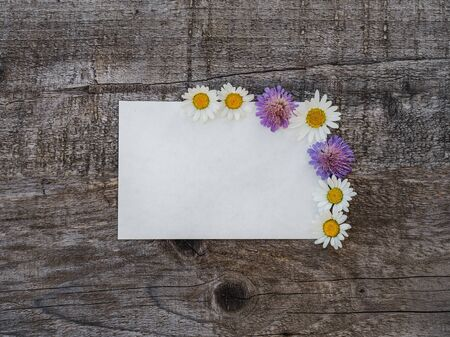 Beautiful bouquet of bright flowers, blank notepad page and unpainted boards. Place for your inscription. Top view, close-up. Congratulations to loved ones, family, relatives, friends and colleagues Reklamní fotografie - 126378130