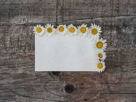 Beautiful bouquet of bright flowers, blank notepad page and unpainted boards. Place for your inscription. Top view, close-up. Congratulations to loved ones, family, relatives, friends and colleagues Reklamní fotografie - 126378129