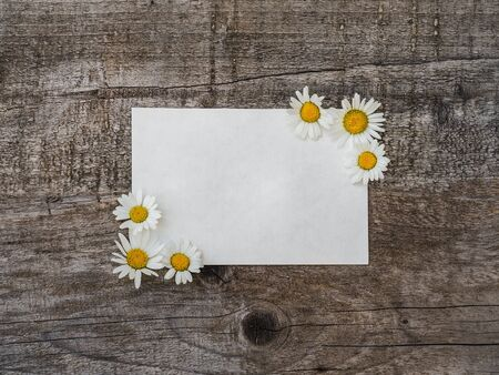 Beautiful bouquet of bright flowers, blank notepad page and unpainted boards. Place for your inscription. Top view, close-up. Congratulations to loved ones, family, relatives, friends and colleagues Reklamní fotografie - 126378132