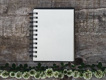 Beautiful bouquet of bright flowers, blank notepad page and unpainted boards. Place for your inscription. Top view, close-up. Congratulations to loved ones, family, relatives, friends and colleagues Reklamní fotografie - 126378135