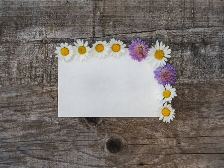 Beautiful bouquet of bright flowers, blank notepad page and unpainted boards. Place for your inscription. Top view, close-up. Congratulations to loved ones, family, relatives, friends and colleagues Reklamní fotografie