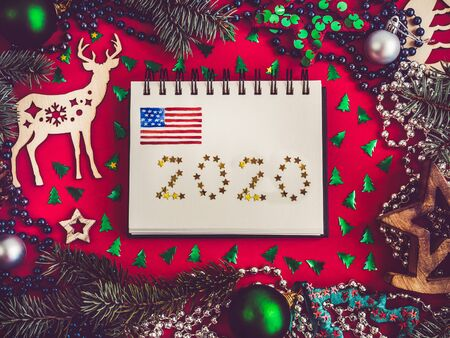 Merry Christmas and Happy New Year. Beautiful card with American flag pattern. View from above, close-up, flat lay. Congratulations to loved ones, family, relatives, friends and colleagues 스톡 콘텐츠