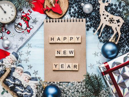 Notepad, Christmas decorations, Christmas tree branches and gift boxes. View from above, close-up, flat lay. Congratulations to loved ones, family, relatives, friends and colleagues Zdjęcie Seryjne