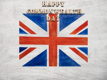 Beautiful, bright card with congratulations on the British holidays. Isolated background, close-up, view from above. Congratulations for relatives, friends and colleagues