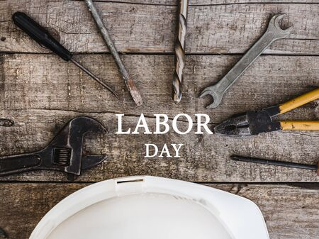 LABOR DAY. Hand tools lying on the table. Top view, close-up. Preparing for the celebration. Congratulations to loved ones, family, relatives, friends and colleagues National holiday concept