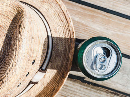 Can of beer on the background of a wooden surface