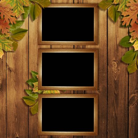 Card for the holiday  with autumn leaves on the wooden background photo