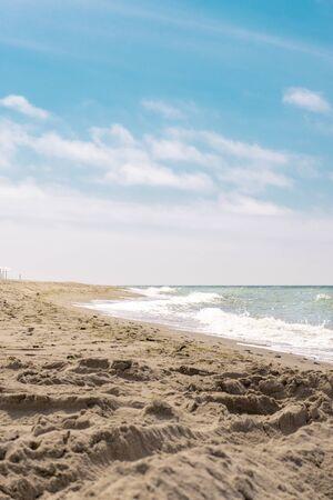 Sandy beach, Baltic sea and blue sky. Reklamní fotografie