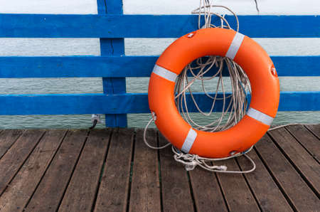 Baltic Sea, wooden pier with life buoy 版權商用圖片