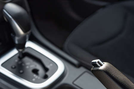 Hand brake in car with automatic transmission, car interior