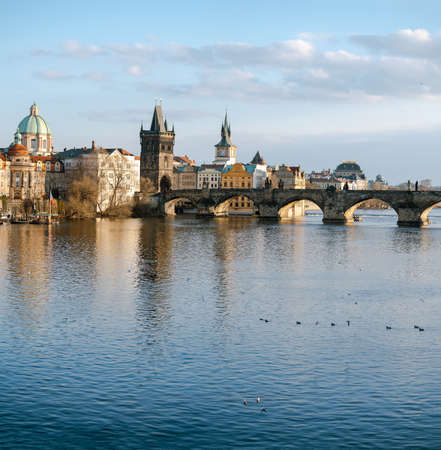 view of Charles Bridge and the Vltava River in the center of Prague before sunset