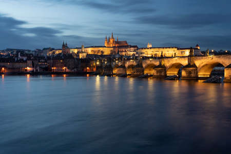 panoramic view of Charles Bridge on the Vltava river and in the background Prague Castle and St. Vitus Cathedral in the center of Prague in the evening Editorial