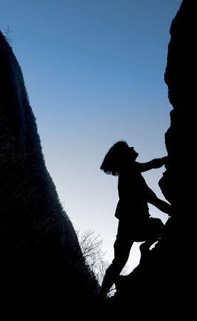A rock climber climbs his way to the top Stock Photo - 3932852