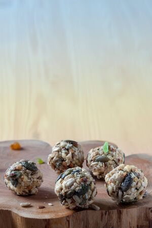 Dates energy homemade no cooked organic seeds nuts vegan oatmeal balls wooden rustic and gradient blue background