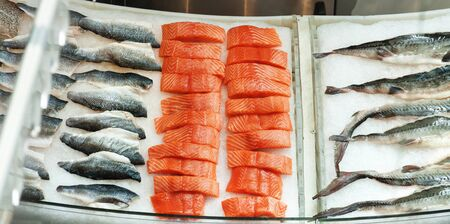 raw fresh seafood on ice at the fish restaurant market