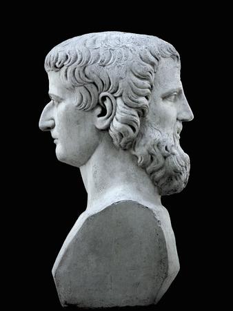 janus: Janus sculpture on a black background Stock Photo