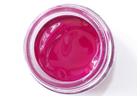 gouache: A jar of magenta color gouache on a white background Stock Photo