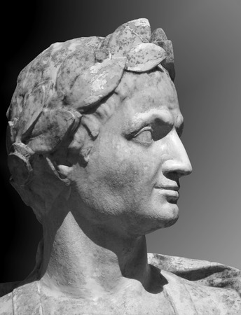 pontiff: Gaius Julius Caesar sculpture on a gray background. Marble bust of Roman general in the Summer Garden of Saint Petersburg.