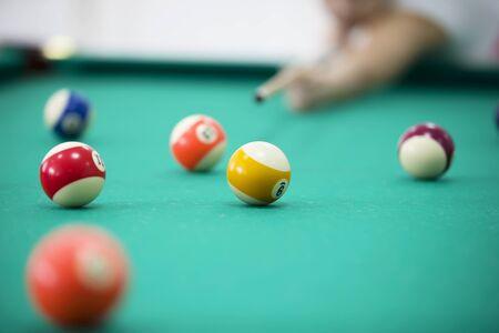 Billiard balls on a green background. Billiards game