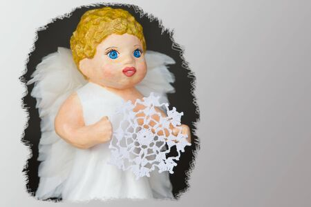 Doll angel with a knitted snowflake close-up