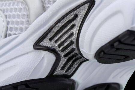 Fragment of a rubber black and white sole of a sneaker. Bottom of sports shoes 版權商用圖片