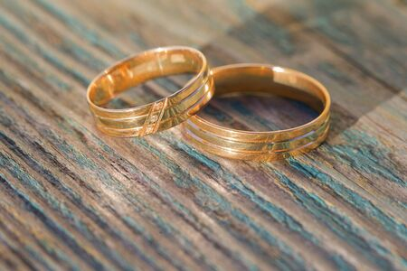 Wedding rings on a wooden background
