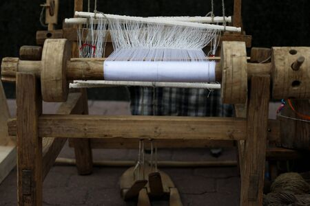 Belarus, Gomel, May 9, 2017, the Victory Day celebration,Ancient spinning machine.An ancient way to fabricate.Loom