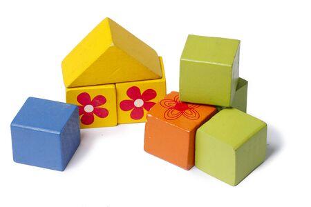 Children's wooden blocks.Concept of building a house 版權商用圖片