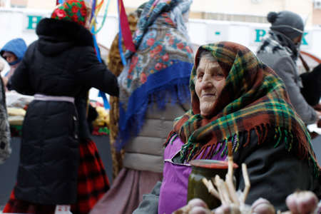 Belarus, Gomel, January 13, 2017. Central market.An old Russian woman in a winter kerchief. An old poor woman. An old beggar woman Editorial