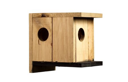 Wooden birdhouse on a white background