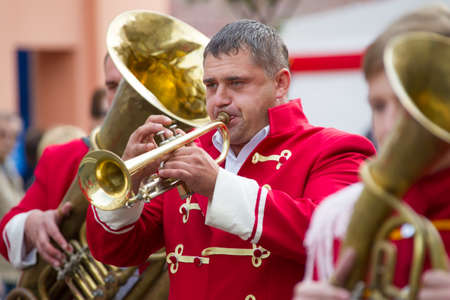 Belarus, Gomel, September 16, 2017. Celebrating the city day.The musician is playing on the trumpet. A man participates in an orchestra. Trumpeter blows into the pipe
