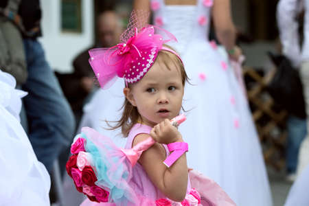 Little girl with a wedding bouquet