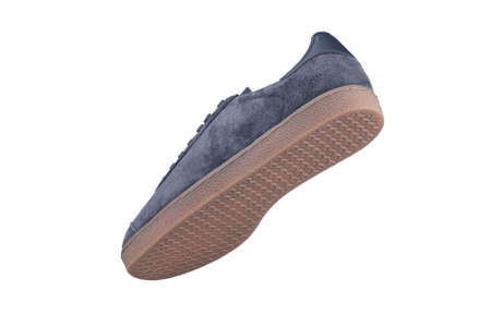 Suede sneaker on a white background. Men's sports shoes.