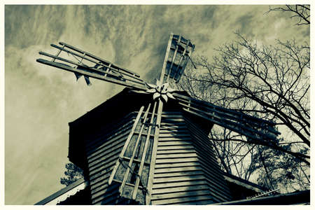 Retro colorless postcard old mill
