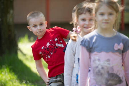 Belarus, the city of Gomil, April 26, 2019. Kindergarten on the street.A boy from kindergarten on a summer walk on the background of blurry children