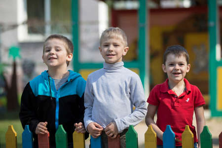 Belarus, the city of Gomil, April 26, 2019. Kindergarten on the street.Three boys from kindergarten for a walk. 報道画像