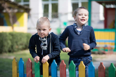 Belarus, the city of Gomil, April 26, 2019. Kindergarten on the street.Two little friends are playing. Kindergarten boys in the playground