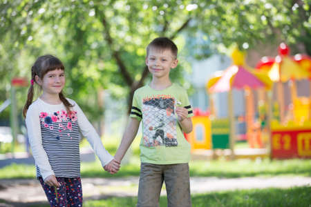 Belarus, the city of Gomil, April 26, 2019. Kindergarten on the street.Cheerful children from kindergarten on a summer walk. Six year old boy and girl play in the garden. Editorial