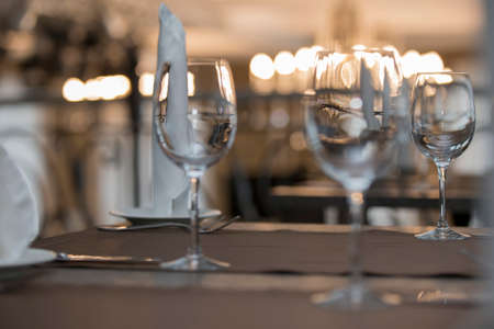 Glass goblets on the restaurant table.