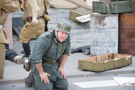 Belarus, Gomel. May 9, 2018. Victory Day. Reconstruction take Reichstag. The loser desperate German soldier fascist of the second world war cries.