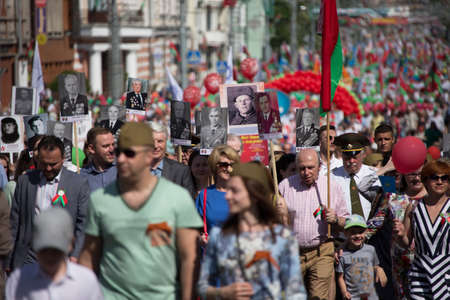 Belarus, the city of Gomel, May 9, 2018. Holiday Victory Day. Central Park.Many people walk down the street on Victory Day Editorial