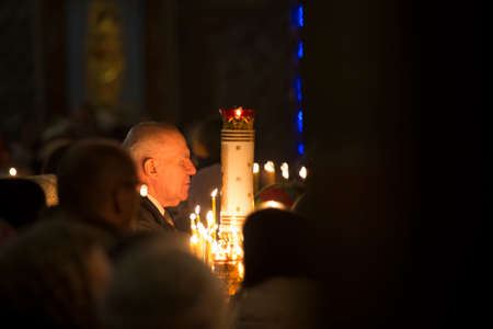 Belarus, Gomel, January 7, 2018. The central church, the Feast of the Nativity. A crowd of people in the church. A man praying to God. Editoriali