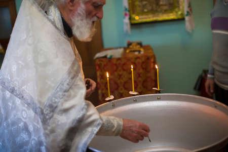 Belarus, Gomel, January 19, 2019. Prudkovsky church. An Orthodox priest is preparing a font for baptism. Orthodox baptism