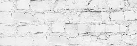 Close up white brick wall banner. Rough background. 写真素材