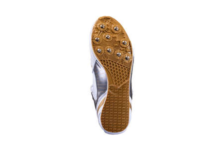 Sneaker sole with spikes on a white background Foto de archivo
